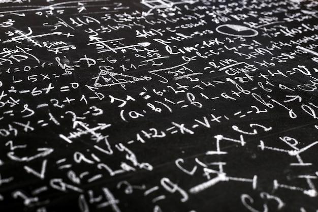 Math and physics equations on a blackboard Premium Photo