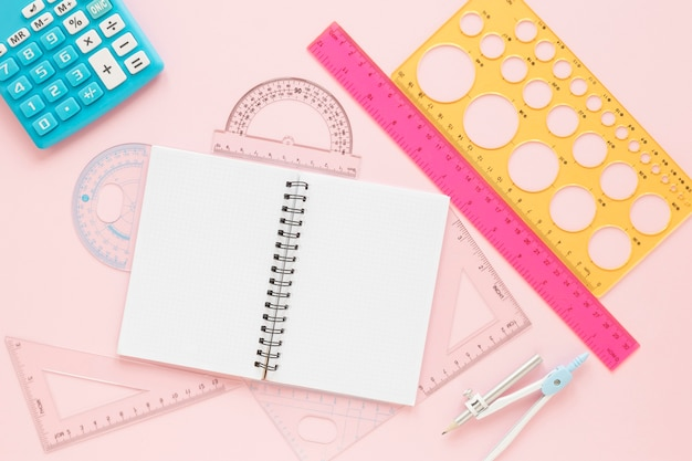 Math rulers supplies with open empty notebook flat lay Free Photo