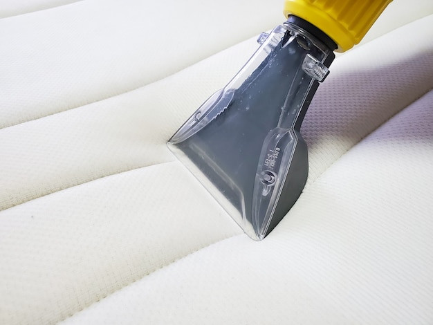 Mattress dry cleaning with professional extraction method. close up Premium Photo
