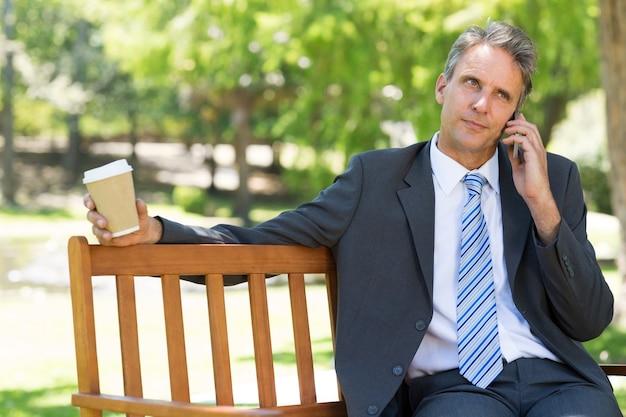 Mature businessman using cellphone Premium Photo