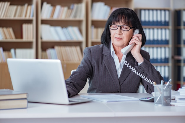 Mature businesswoman working in the office Premium Photo