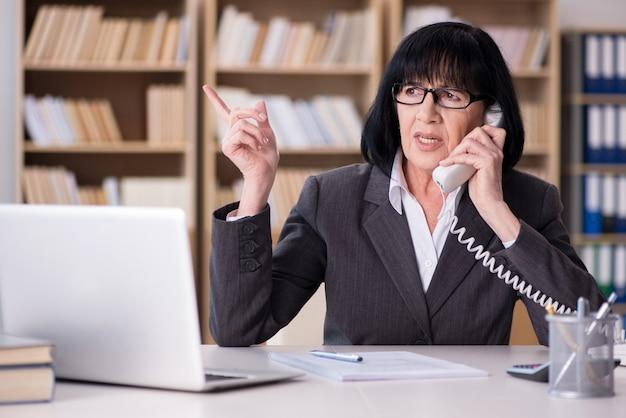 Mature businesswoman working in the office Premium Photo