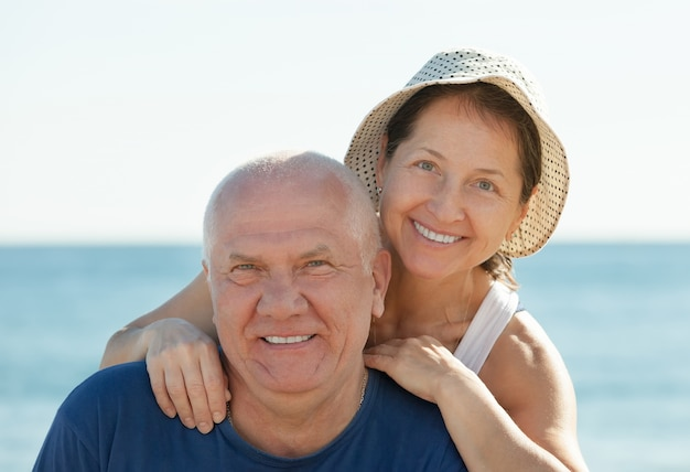 Couple Mature mature couple at sea beach photo | free download