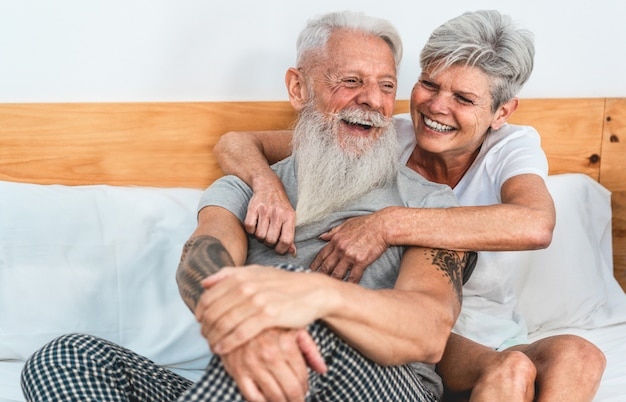 Mature couple enjoying time together at home after waking up Premium Photo