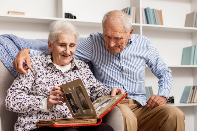 Mature Couple Looking Into Photo Album Photo  Free Download-5045