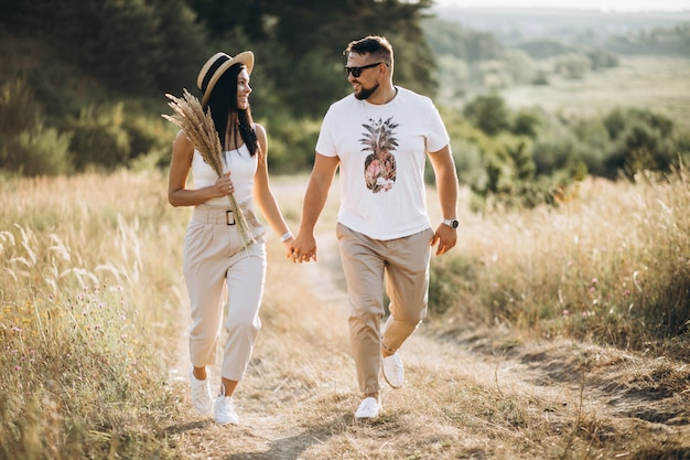 Mature couple walking together in field Free Photo