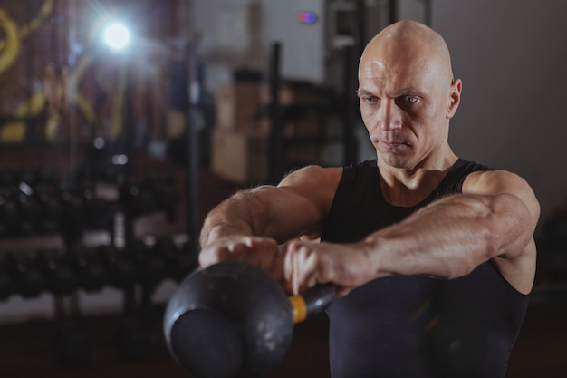 Mature crossfit athlete exercising with kettlebell Premium Photo