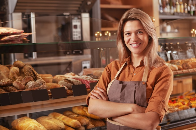 Mature female baker working at her bakery store Premium Photo