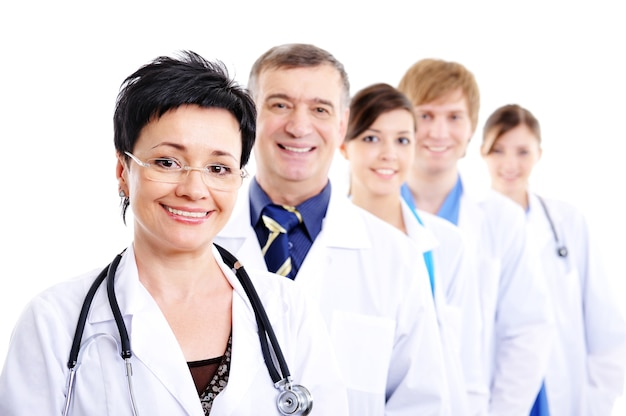 Mature female doctor with group of happy successsful colleagues Free Photo