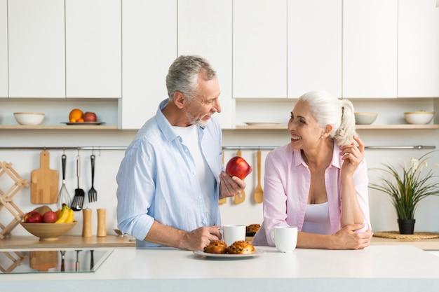Mature loving couple family standing at the kitchen Free Photo