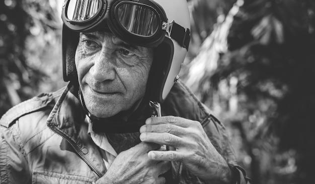 Mature man putting on a helmet Free Photo