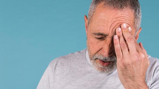 Mature man suffering from headache Free Photo