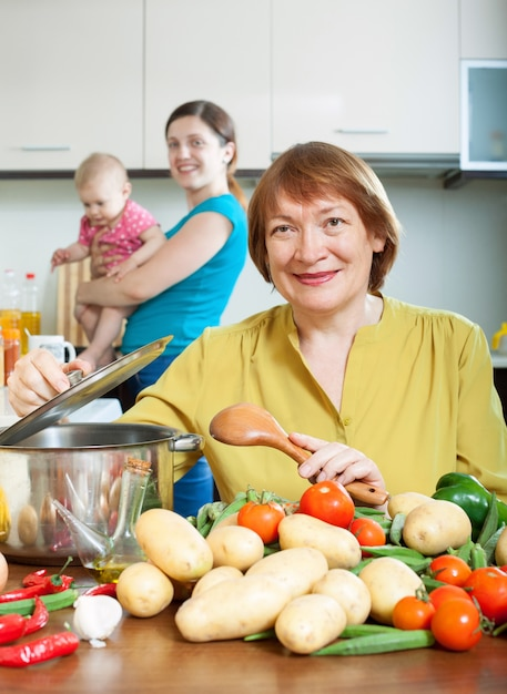 Mature woman cooking veggie lunch in kitchen Free Photo