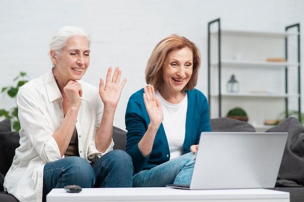 Mature woman having a video call Free Photo