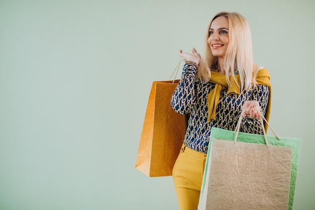 Mature woman with shopping bags Free Photo