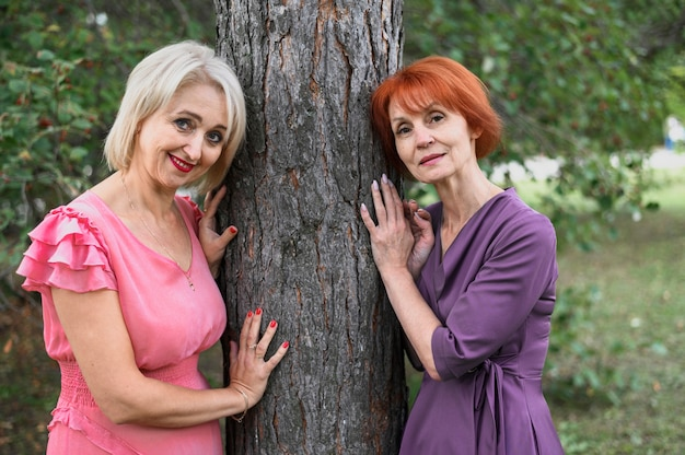 Mature women posing together in the park Free Photo