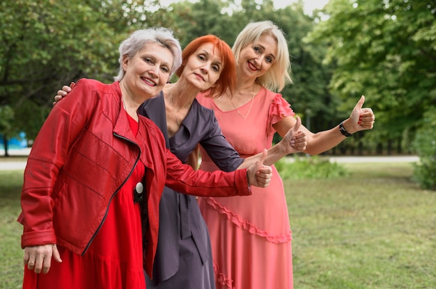 Mature women together in the park Free Photo