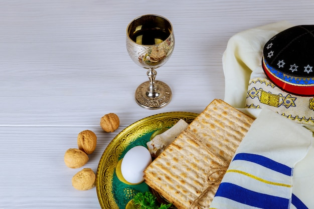 Matzo for passover with metal tray and wine on table Premium Photo