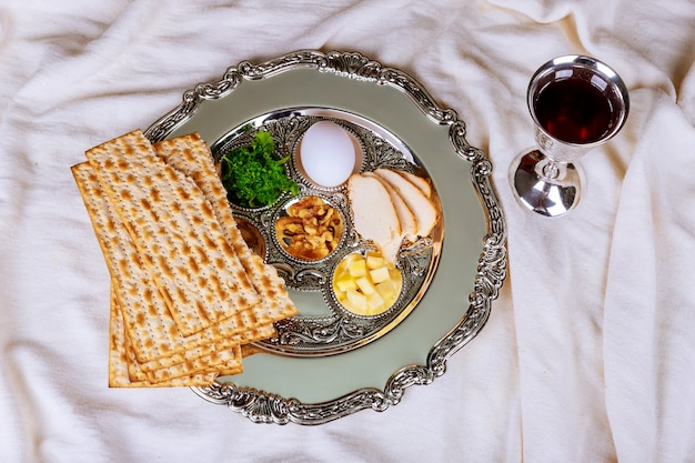 Matzo for passover with seder on plate on table close up Premium Photo