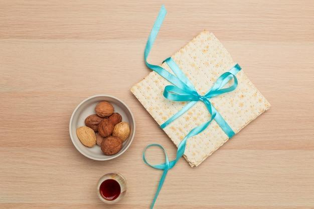Matzoth for jewish passover, wooden background close up Premium Photo