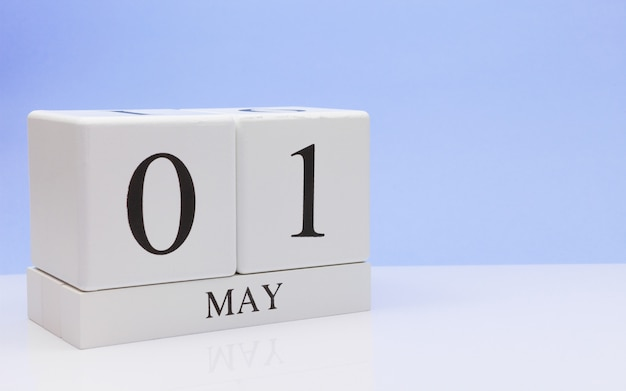 May 01st. day 1 of month, daily calendar on white table Premium Photo