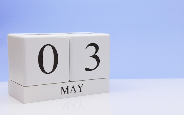 May 03st. day 3 of month, daily calendar on white table Premium Photo