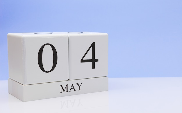 May 04st. day 4 of month, daily calendar on white table Premium Photo