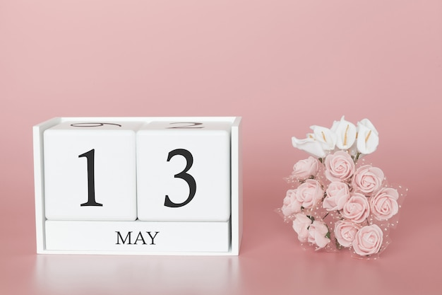 May 13th. day 13 of month. calendar cube on modern pink Premium Photo