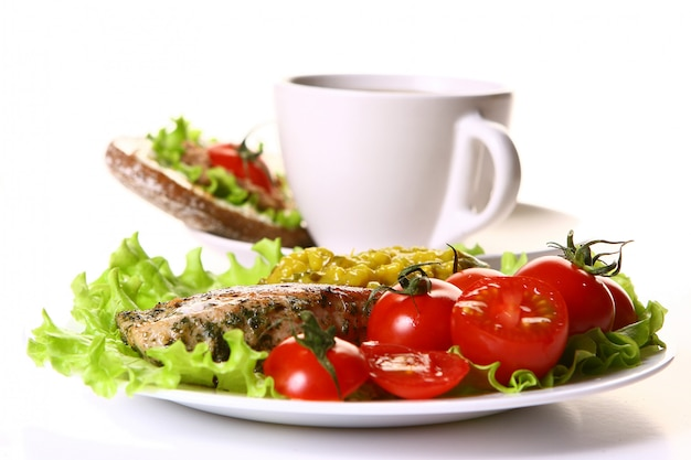 Meal garnish with filet and vegetables and coffee Free Photo