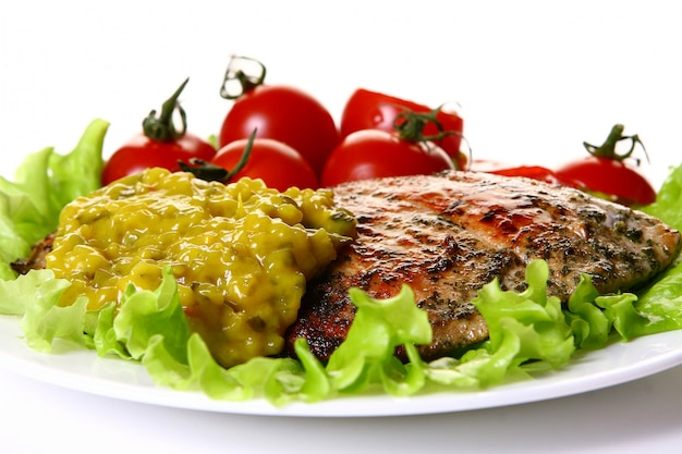 Meal garnish with meat and vegetables Free Photo