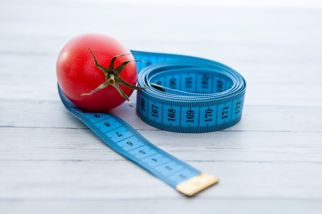 Peachy Measuring Tape And Juicy Tomato The Concept Of Healthy Download Free Architecture Designs Scobabritishbridgeorg