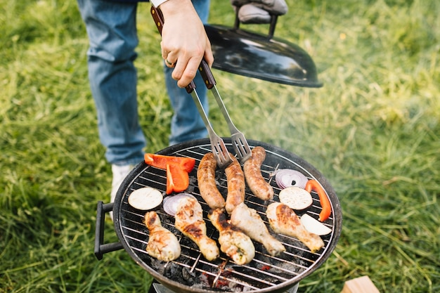 Meat on barbecue grill in nature Premium Photo