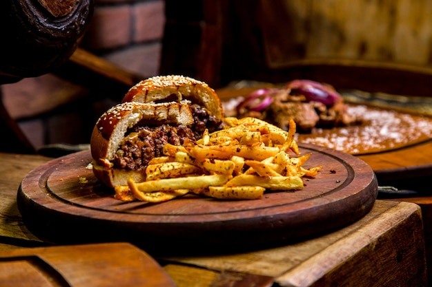 Meat burger french fries spices side view Free Photo