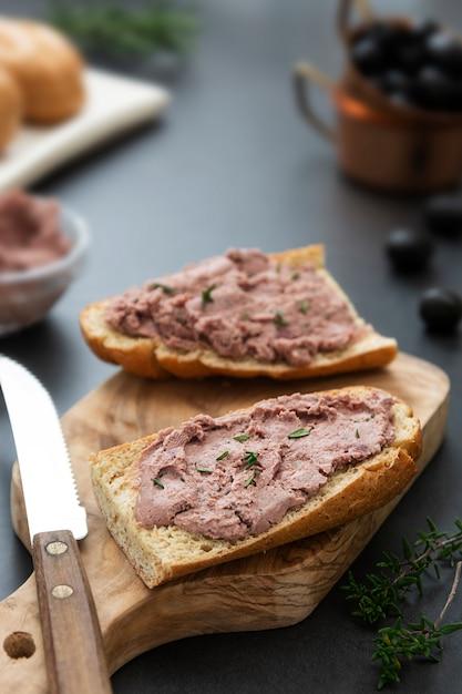 Meat chicken or pork liver pate sandwich over whole grain bread slices Premium Photo