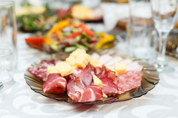 Meat cold cuts on a banquet table. shallow depth of field Premium Photo