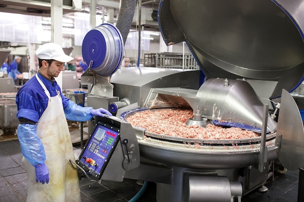 The meat in the grinder. the meat industry. Premium Photo