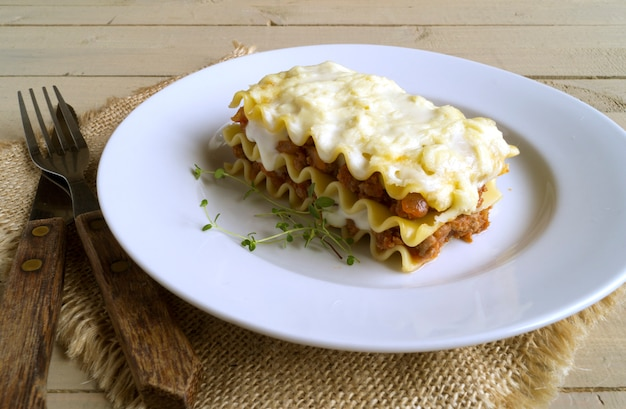 Meat lasagna on a wooden background. Premium Photo