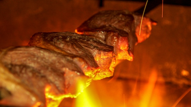 Meat picanha in fire brazil Premium Photo