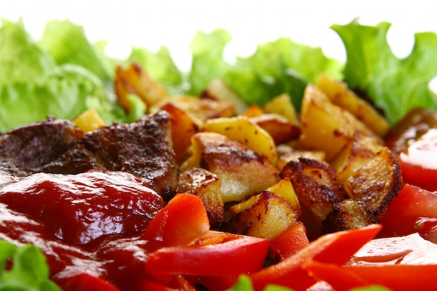 Meat plate with potatoes and souce Free Photo