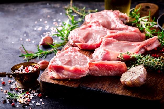Meat raw fresh mutton on the bone spices chesno Premium Photo