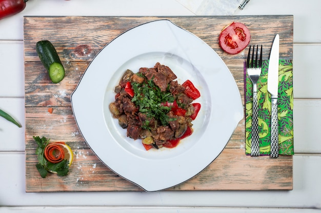 Meat sauteed wih tomato and herbs Free Photo