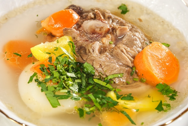 Meat soup with vegetables Premium Photo