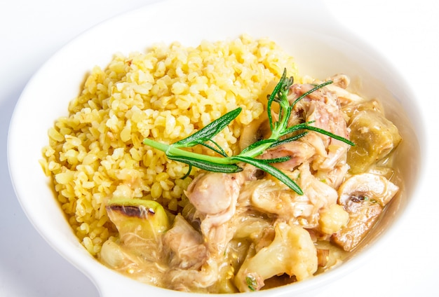 Meat stewed of rabbit closeup on white plate Free Photo