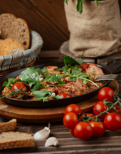 Meat and vegetables stew in a black pan Free Photo