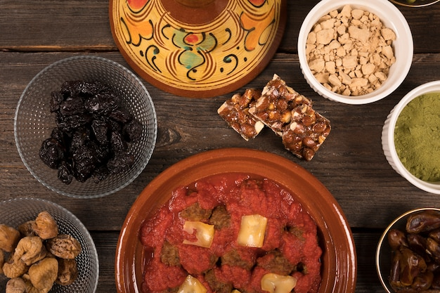 Meat with dried fruits and spices Free Photo