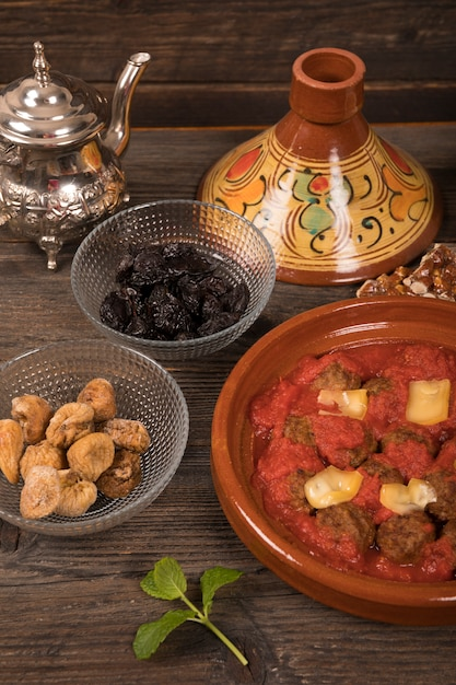 Meat with dried fruits and teapot Free Photo
