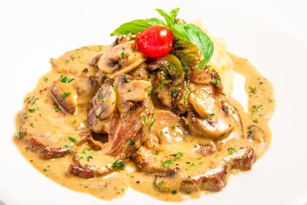 Meat with mushroom cream sauce Free Photo
