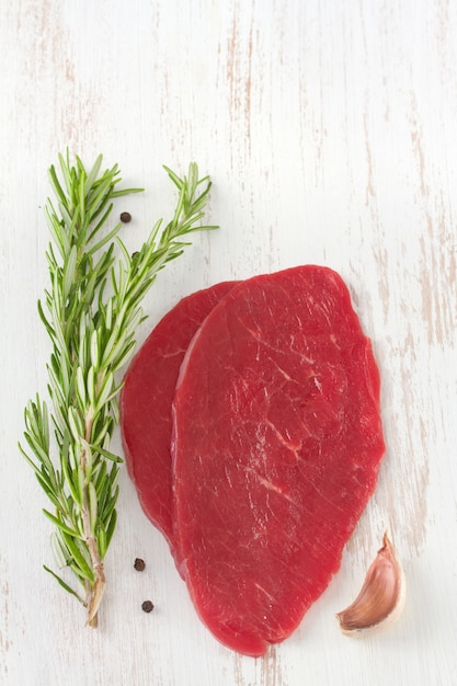 Meat with rosemary Premium Photo