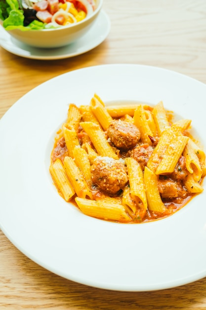 Meatball pasta with sauce Free Photo