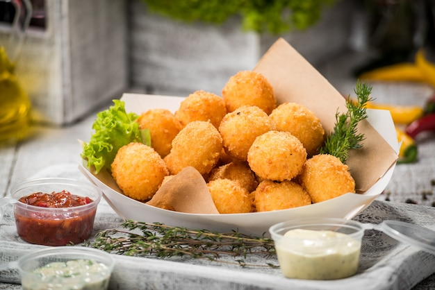Meatballs on sticks in a plate with vegetables Premium Photo